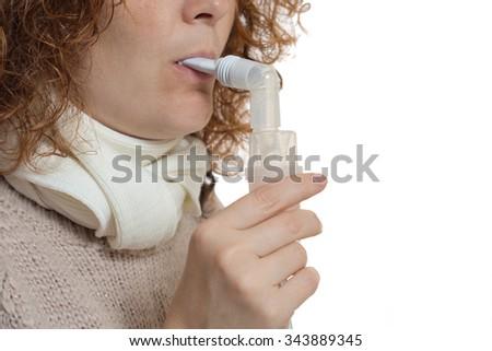 woman makes the procedure inhalation - stock photo