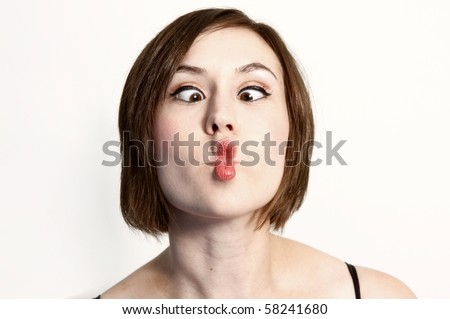 """Woman making a funny face known as  a""""fish-face"""" - stock photo"""
