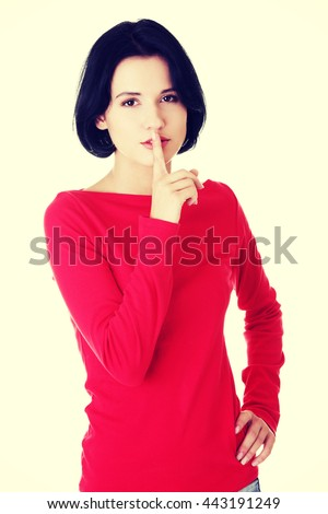 Woman making a keep it quiet gesture - stock photo