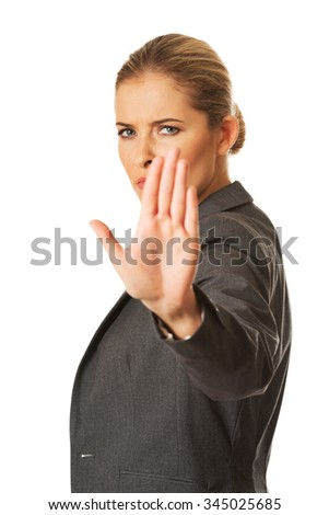 Woman making a stop sign with her hand. - stock photo