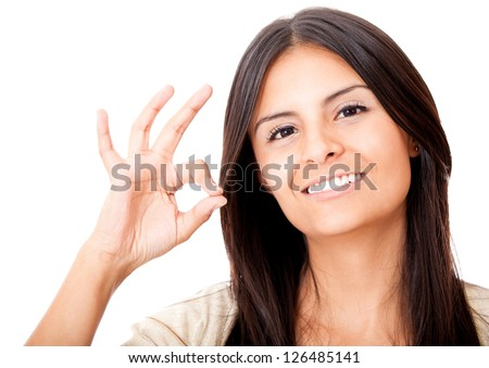 Woman making an ok sign - isolated over a white background