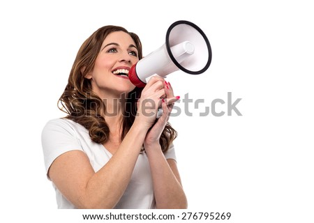 Woman making announcement with megaphone - stock photo