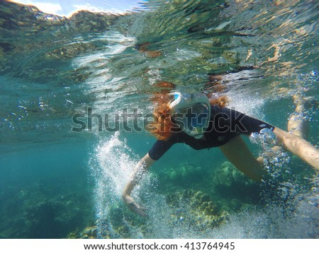 Woman making bubbles, Beautiful woman under water before dive to coral reef, woman snorkeling in blue mask, snorkel woman face in mask, tropical sea snorkeling, summer vacation activity, girl swimming