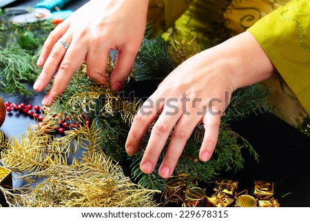 Woman making christmas advent wreath, close up