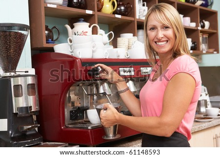 Woman Making Coffee In Cafe - stock photo