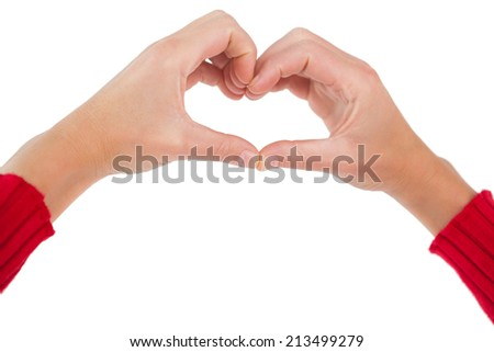 Woman making heart shape with hands on white background