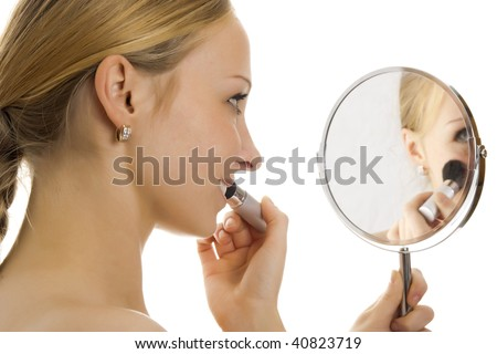 Woman making her make-up. Isolated. - stock photo