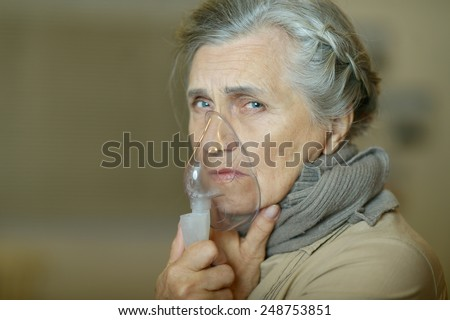 Woman making inhalation - stock photo