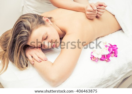 woman making massages in a beauty saloon - stock photo