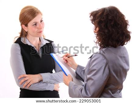 Woman making notes at job interview - stock photo