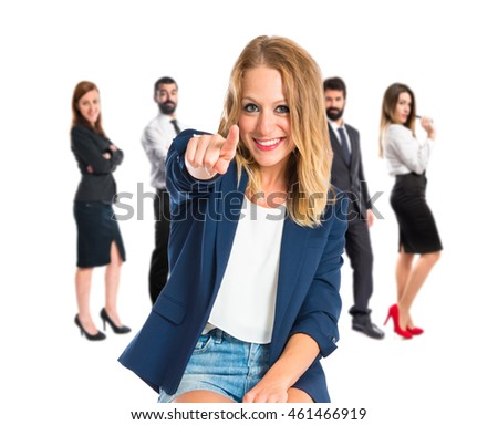 Woman making Ok sign with many people behind