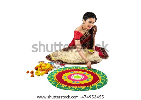 woman making rangoli for diwali