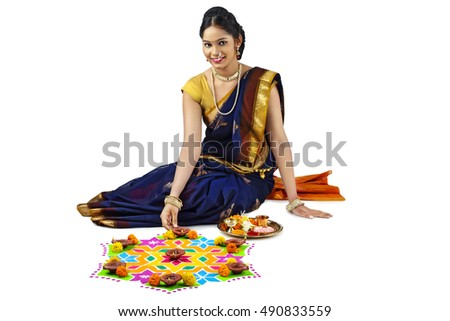 woman making rangoli for Indian festival Diwali
