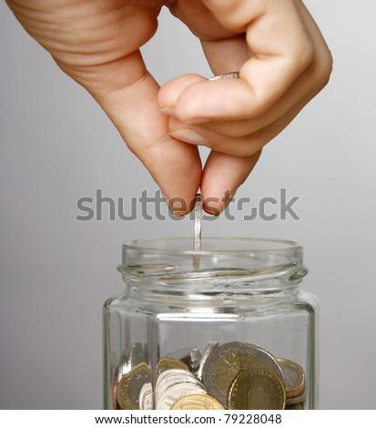 Woman making savings - stock photo