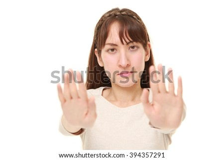 woman making stop gesture - stock photo