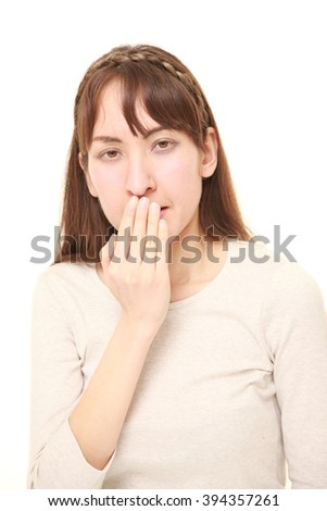 woman making the speak no evil gesture - stock photo