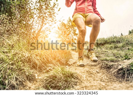 woman making workout and running on the hills. concept about sport and fitness - stock photo