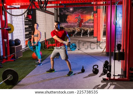 woman man gym group weightlifting workout exercise - stock photo