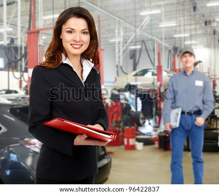 Woman manager in auto repair service. Garage. - stock photo
