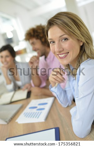 Woman manager with employees team - stock photo