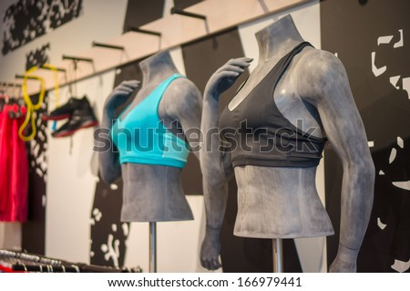 Woman mannequins in sport light tops bra on stands in sport store - stock photo