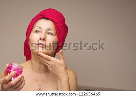Woman mask on her face. - stock photo