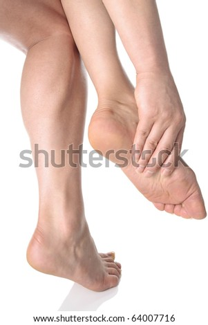 Woman massaging aching feet over white