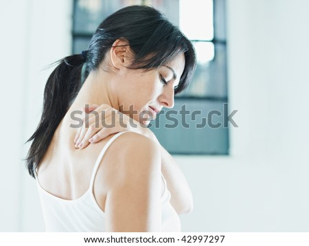 woman massaging neck. Side view, copy space - stock photo