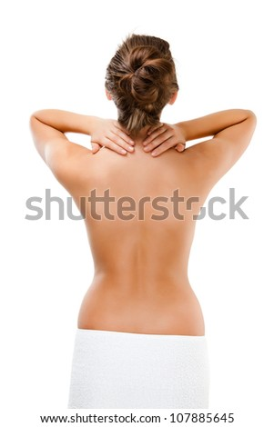 Woman massaging pain back isolated on white background - stock photo