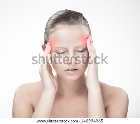 Woman massaging pain head - stock photo