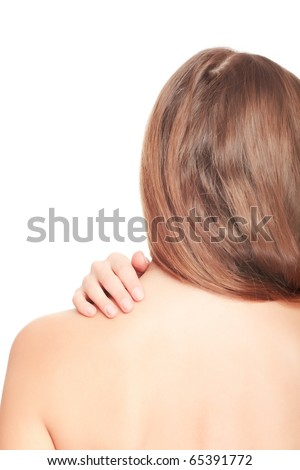 Woman massaging pain in her back, isolated on white background. - stock photo