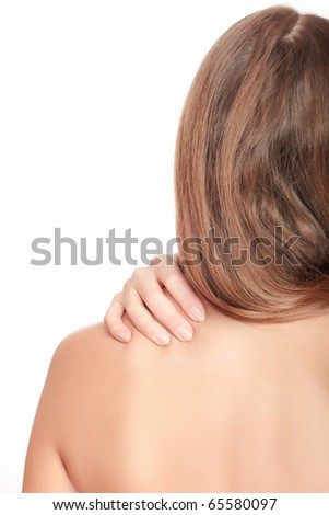 Woman massaging pain in her back, isolated on white background.