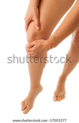 Woman massaging pain knee isolated on a white background
