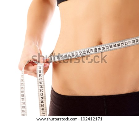 woman measure her waist belly by metre-stick - stock photo