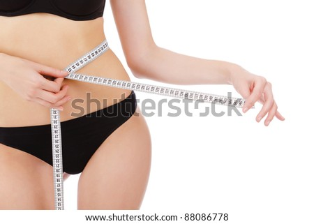 woman measures her waist belly, isolated on white background - stock photo