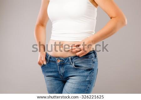 Woman measuring body - stock photo