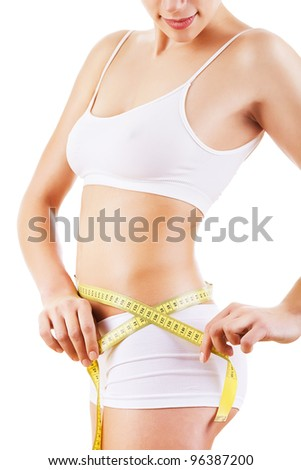 woman measuring her shapes on white background
