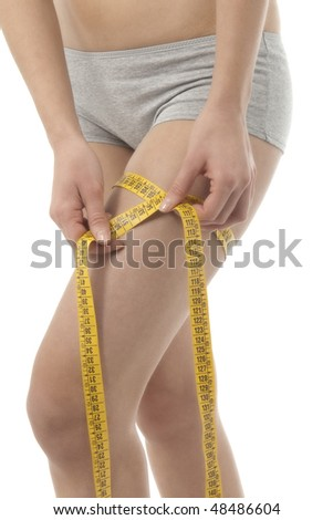 Woman measuring her thigh - stock photo