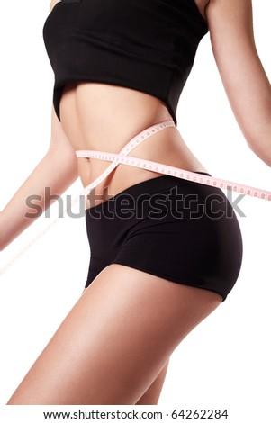 Woman measuring her waist - stock photo