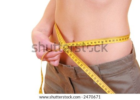 woman measuring her waist with a tape measure isolated on white