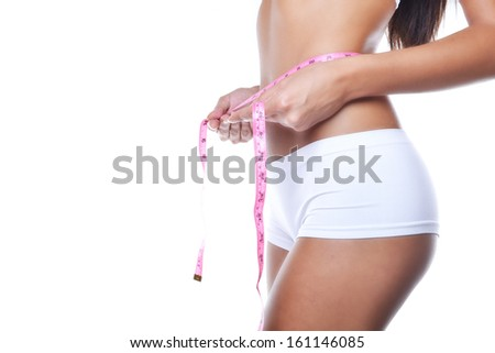 woman measuring herself, isolated on white, body care concept