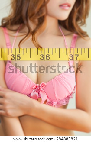 Woman measuring perfect shape - stock photo