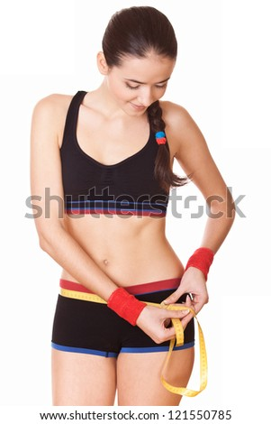 woman measuring perfect shape hips, lifestyle concept - stock photo