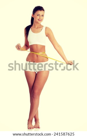 Woman measuring perfect shape of beautiful body. Healthy lifestyles concept - stock photo