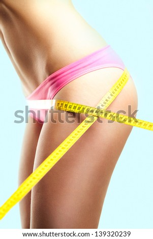 Woman Measuring Perfect Shape Of Beautiful Hips - stock photo