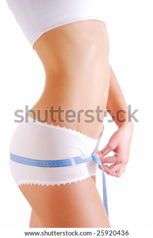 Woman measuring perfect shape of beautiful hips. Healthy body concept - stock photo