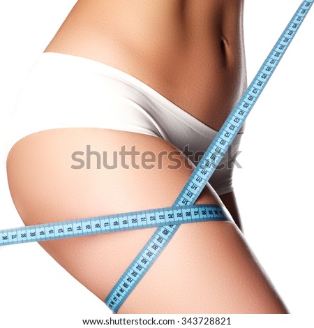 Woman measuring perfect shape of beautiful hips. Healthy lifestyles concept. Woman body part is being measured. Spa beauty part of body. Healthy lifestyle diet and fitness Perfect waist, butt and legs - stock photo