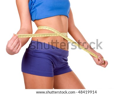 Woman measuring perfect shape of beautiful thigh. Healthy lifestyles - stock photo