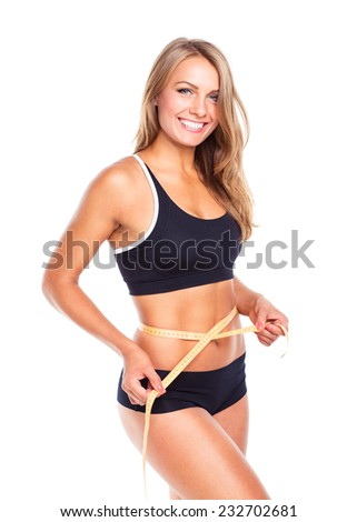 Woman measuring perfect shape of beautiful thigh, healthy lifestyles concept - stock photo