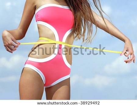 woman measuring perfect shape of beautiful thigh healthy lifestyles concept - stock photo